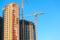 Construction of Highrise buildings with cranes Royalty Free Stock Photo