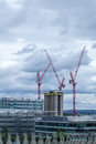 Construction industry over the London skyline. High rise tower b Royalty Free Stock Photo