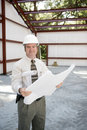 Construction Inspector with Blueprints Stock Image