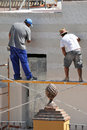 Construction mason renovating the facade of a house Royalty Free Stock Photo
