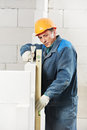 Construction mason worker bricklayer with level Royalty Free Stock Image