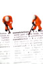 Construction model workers dictionary a photograph of the word in with minature scale Stock Photo