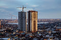 Construction of modern skyscrapers in low-rise area of the city of Voronezh