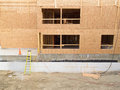 Construction of new building empty window openings exterior view home with still being a deserted site like after Royalty Free Stock Images