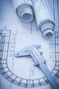 Construction plans metal vernier caliper on Royalty Free Stock Photo