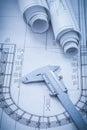Construction plans metal vernier caliper on Royalty Free Stock Photo
