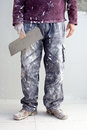 Construction plaster plaster man dirty trousers Stock Image