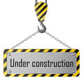 Construction plate with crane hook and chain metallic Royalty Free Stock Image