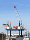 Construction platform for offshore wind energy plants being loaded at the harbor of bremerhaven Stock Images