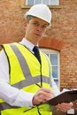 Construction professional with clipboard Royalty Free Stock Photo