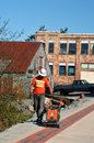Construction project in sitka alaska may worker finishes up on sidewalk reconstruction job alaska Royalty Free Stock Image