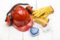 Construction protective workwear background with on white floor boards Stock Images