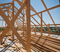 Construction of a roof timber frame brick house sunny day Royalty Free Stock Photo