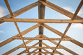 Construction of roof wooden pine symmetric skeleton and blue sky Royalty Free Stock Images