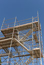 Construction scaffolding tall building or against blue sky Stock Image