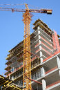 Construction site. Crane and High-rise Building Under Construction. Royalty Free Stock Photo