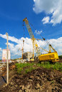 Construction site cranes on the beneath blue cloudy sky Royalty Free Stock Photos