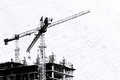 Construction site with cranes on silhouette with drawing background Royalty Free Stock Photo