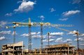 Construction site with cranes in sky Royalty Free Stock Images