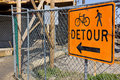 Construction site detour sign for sidewalk at a Royalty Free Stock Images