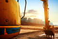 Construction site excavator big on new in the background the blue sky and sun Stock Photo