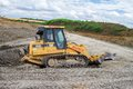 Construction Site with heavy excavating machinery Royalty Free Stock Photo