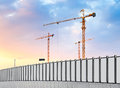 Construction site industrial landscape with cranes and pipe Royalty Free Stock Image