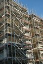 Construction site of a large residential building outer walls covered  with scaffolding Royalty Free Stock Photo