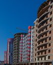 Construction site of a new apartment high building against blue sky. Residential area development. Real estate project growth conc Royalty Free Stock Photo