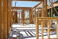 Construction site in progress wood frames for a house are put up and supported temporary Stock Photography