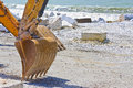 Construction site by the sea for the realization of an embankment Royalty Free Stock Photo