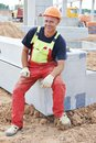 Construction site worker one adult smiling happy at building area Stock Images