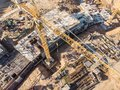 Construction site with yellow building crane Royalty Free Stock Photo