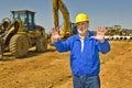 Construction supervisor directing traffice horizontal shot of on work site traffic Royalty Free Stock Image