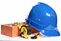 Construction tools, hardhat, brick and blueprint Stock Photos