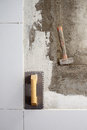 Construction tools notched trowel and hammer Royalty Free Stock Image