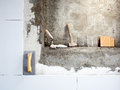 Construction tools notched trowel and hammer Stock Photo