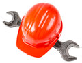 Construction tools photo red safety cap and steel wrench close up on white background full face Stock Photography