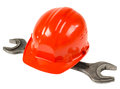 Construction tools photo red safety cap and steel wrench close up on white background full face Stock Photos
