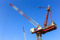 Construction tower crane against blue sky Stock Image