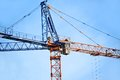 Construction tower crane color against blue sky Royalty Free Stock Photography