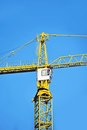 Construction tower crane yellow against blue sky Stock Images