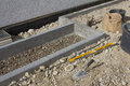 Construction of walkway and flowrebed bordering with curb stones Stock Photo
