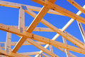 Construction wood frame of a roof against a blue sky Royalty Free Stock Photo