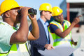 Construction worker binoculars african using looking at site Stock Images