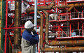 Construction worker and building indutry inside large plant pipes pipelines Royalty Free Stock Photography