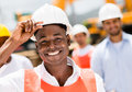 Construction worker at a building site happy wearing helmet Stock Photography