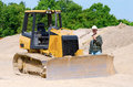 Construction worker and bulldozer Royalty Free Stock Image