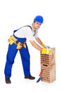 Construction worker with ceramic bricks isolated Royalty Free Stock Images