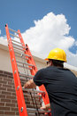 Construction Worker Climbs Ladder Royalty Free Stock Photo